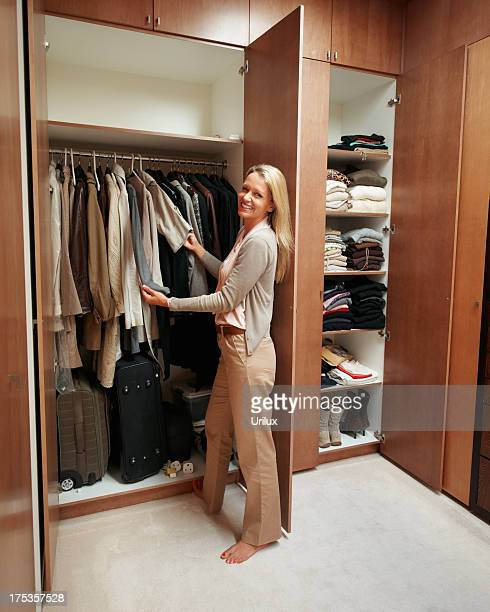 Female looking through her wardrobe and choosing clothes