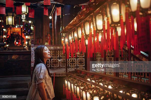 Female looking up and admiring the red lanterns