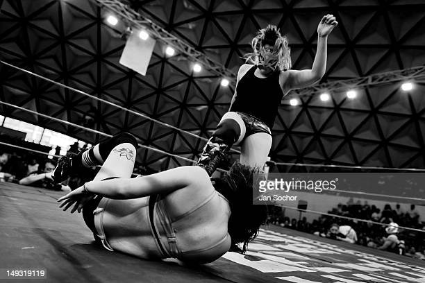 A female Lucha libre wrestler Keira kicks down her rival Sexy Polvora during a fight at Arena Plan Sexenal on April 29 2012 in Mexico City Mexico...