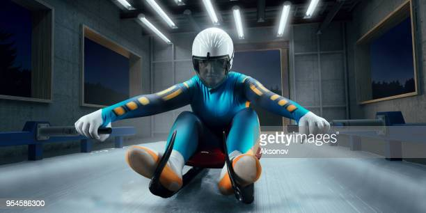 athlète féminine de luge dans la ligne de départ - événement sportif d'hiver photos et images de collection