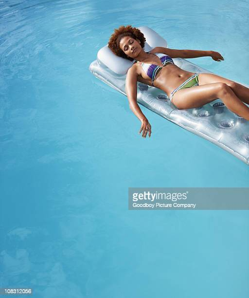 Female lying peacefully on an inflatable float