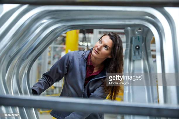 female maintenance engineer examining car chassis - chassis stock pictures, royalty-free photos & images