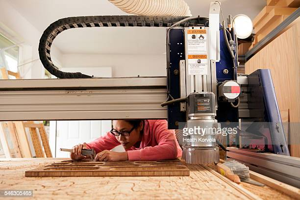 female maker doing hand work in garage workshop. - thai ethnicity stock pictures, royalty-free photos & images