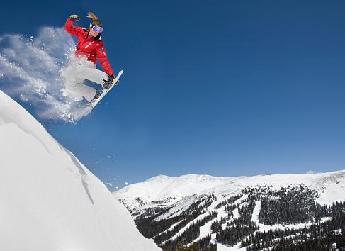 Female Making Extreme Snowboard Jump - gettyimageskorea