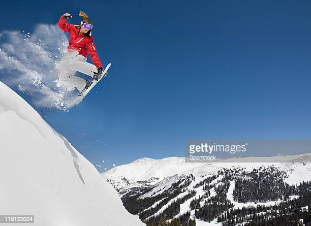 female making extreme snowboard jump - boarding stock pictures, royalty-free photos & images
