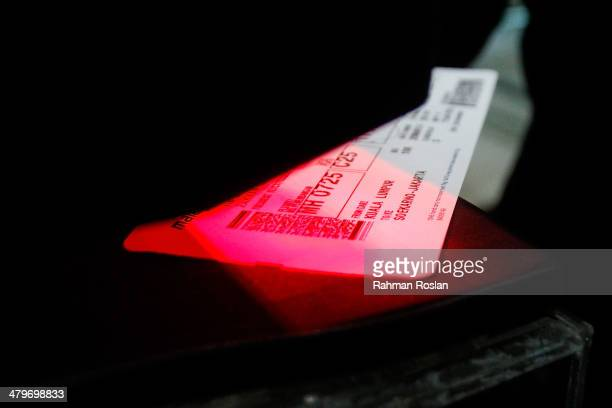 A female Malaysian Royal Police officer scans a passenger's ticket at the departure gate in Kuala Lumpur Internationa Airport March 20 2014 in Kuala...