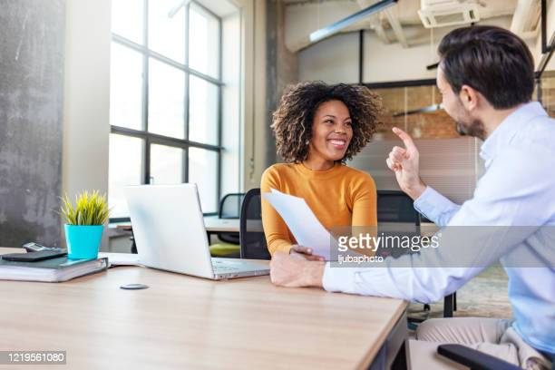 female manager broker consulting client in corporate office with laptop - marketing stock pictures, royalty-free photos & images