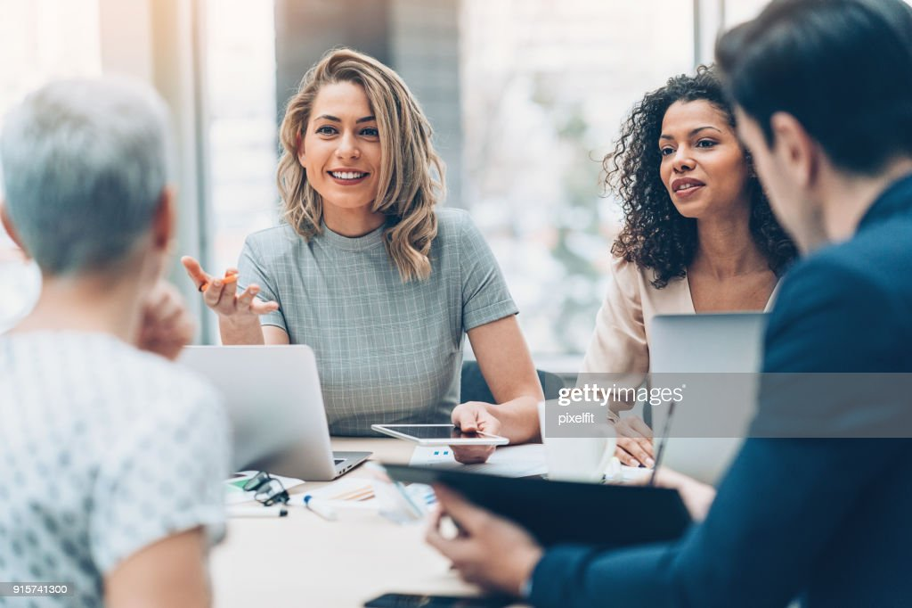 Female manager discussing business : Foto stock