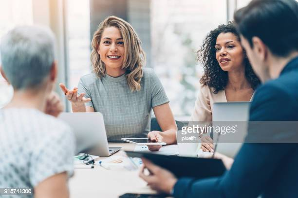 female manager discussing business - business finance and industry stock pictures, royalty-free photos & images