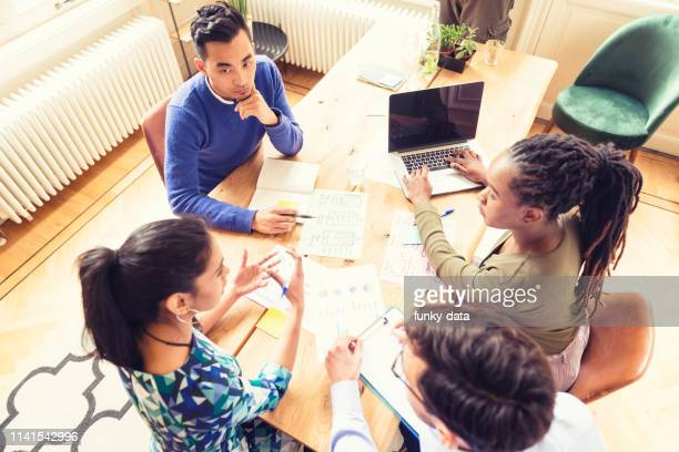 female manager of a diverse business team - minority groups stock pictures, royalty-free photos & images