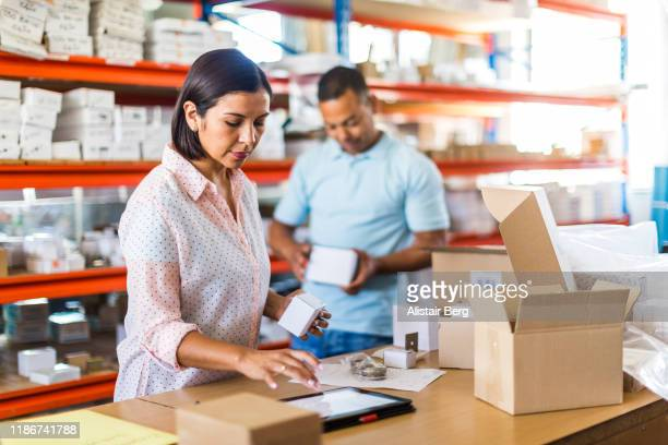 female manager using tablet computer in a small business - e commerce stock pictures, royalty-free photos & images