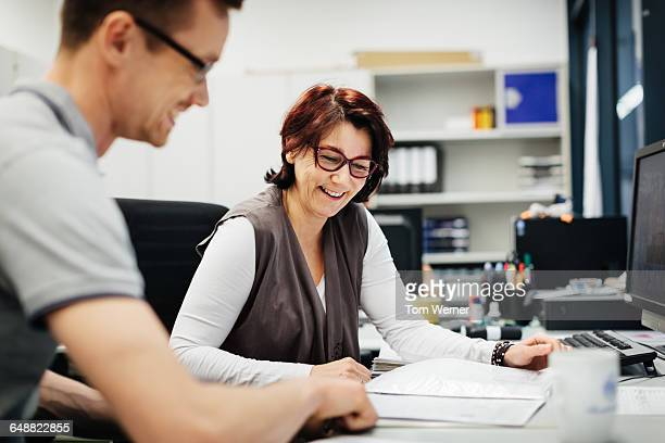Female Manager with a worker in her office
