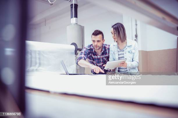 Female Manager Working With Maintenance Engineer In Factory