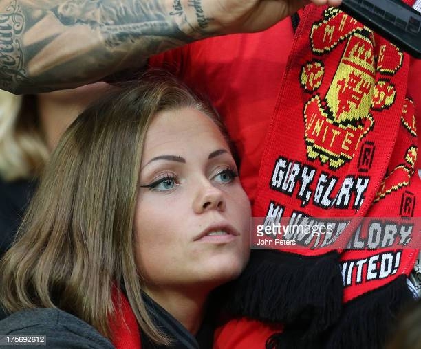 A female Manchester United fan waits in the stands ahead of the preseason friendly match between AIK Fotboll and Manchester United at Friends Arena...