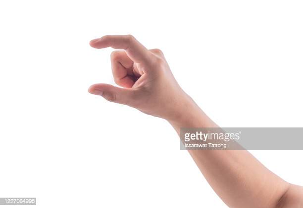 female manicured hand measuring invisible items, woman's palm making gesture while showing small amount of something on white isolated background, side view, close-up, cutout, copy space - dedo humano imagens e fotografias de stock