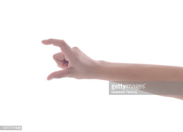 female manicured hand measuring invisible items, woman's palm making gesture while showing small amount of something on white isolated background, side view, close-up, cutout, copy space - greeting card stock pictures, royalty-free photos & images