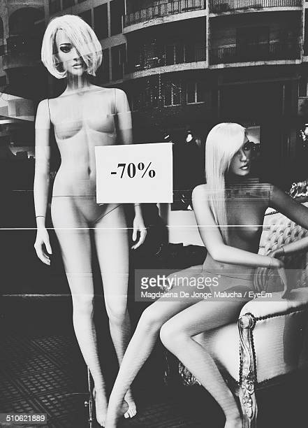 female mannequins in store window - human trafficking stock photos and pictures