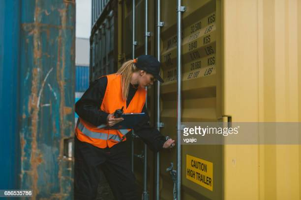 female manual worker checking cargo containers - customs stock pictures, royalty-free photos & images