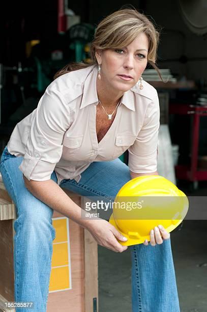 Female Manufacturing Employee Sitting On Break