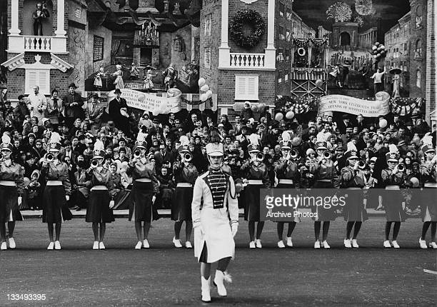 A female marching band during the Macy's Day Parade at Thanksgiving in New York City 26th November 1961 A number of tableaux behind commemorate...