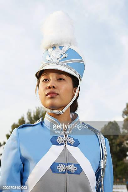 female marching band member in full uniform, outdoors, portrait - marching band stock pictures, royalty-free photos & images