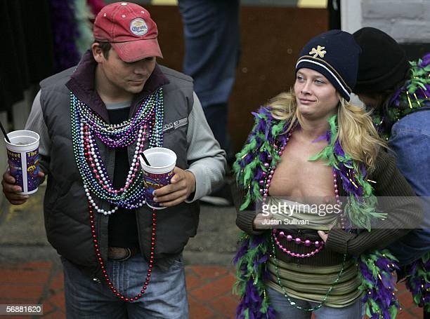 A female Mardi Gras reveler bares her breasts on Bourbon Street February 18 2006 in the Garden District of New Orleans Louisiana New Orleans kicked...