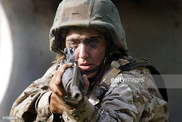 Female Marine Corps recruit Christina Belland of Wyoming Minnesota goes through urban warfare training at the United States Marine Corps recruit...