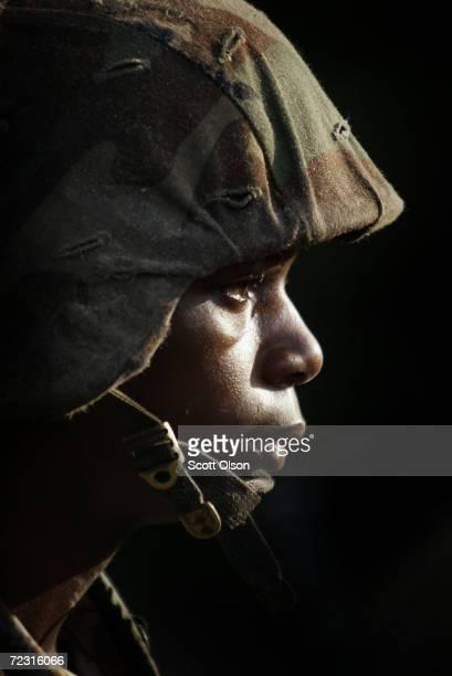 Female Marine Corps recruit Markeisha Richardson of St Louis Missouri listens to instructions before going through urban warfare training at the...