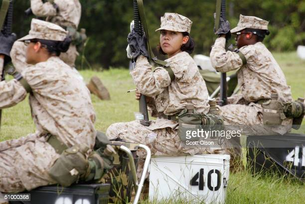 Female Marine Corps recruits wait for a turn to shoot on the rifle range at the United States Marine Corps recruit depot June 21 2004 in Parris...