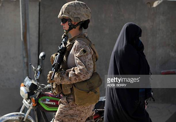 US Female Marine Gunnery Sargeant Michelle Mollen of the 2nd Battalion 1st Marines Regiment patrols in Garmser Helmand Province Afghanistan on March...