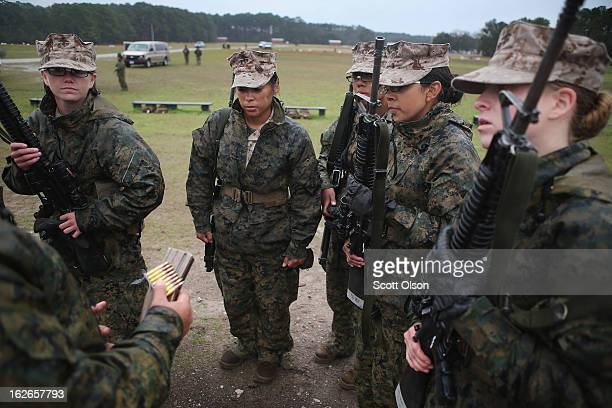 Female Marine recruits receive instructions before firing on the rifle range during boot camp February 25 2013 at MCRD Parris Island South Carolina...