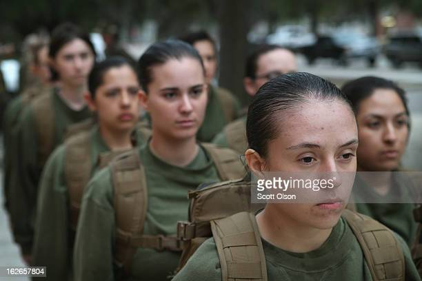 Female Marine recruits stand in formation during boot camp February 25 2013 at MCRD Parris Island South Carolina All female enlisted Marines and male...