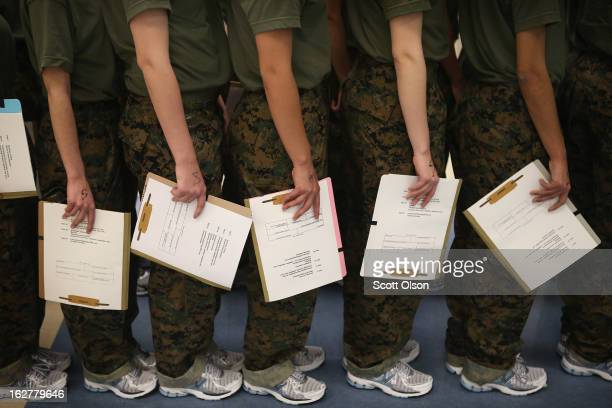 Female Marine recruits stand in line while they wait for a dental examination on their first full day of boot camp on February 26 2013 at MCRD Parris...