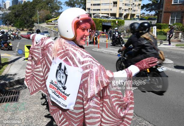 A female marshall directs motorcyclists during a charity ride on September 30 2018 in Sydney Australia The Distinguished Gentleman's Ride is an...