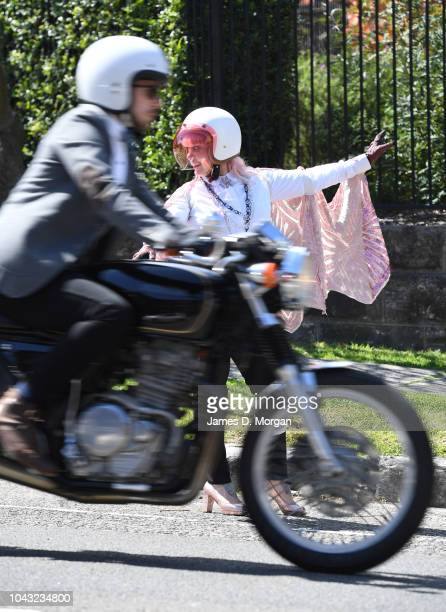A female marshall directs riders during the ride on September 30 2018 in Sydney Australia The Distinguished Gentleman's Ride is an annual event held...