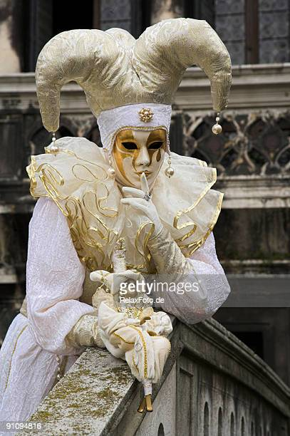female mask with white jester costume at carnival in venice - harlequin stock photos and pictures