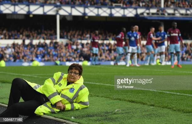 A female match steward keeps an eye on proceedings during the Premier League match between Everton FC and West Ham United at Goodison Park on...