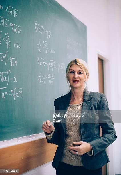 Female math professor in lecture hall