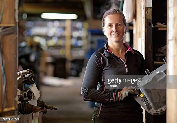 Female mechanic at a storage centre