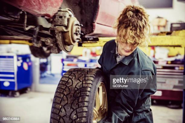 Female Mechanic Changing Tire