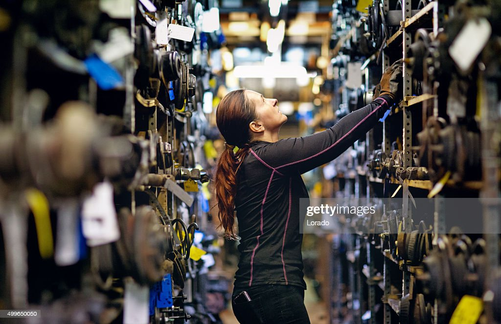 female mechanic organising storage : Stock Photo