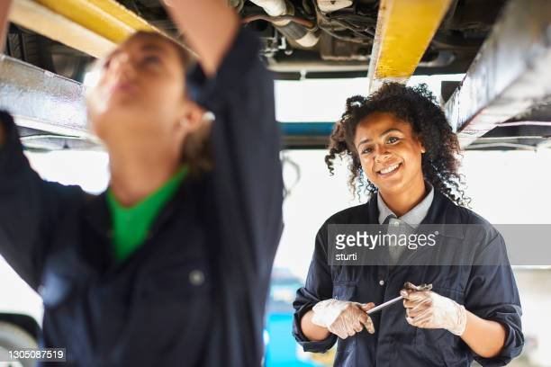 female mechanic portrait - 2015 stock pictures, royalty-free photos & images