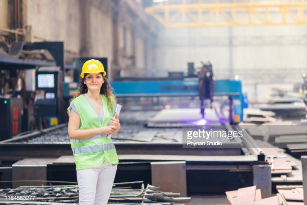 female mechanic  standing near cnc - liquid crystal display stock pictures, royalty-free photos & images