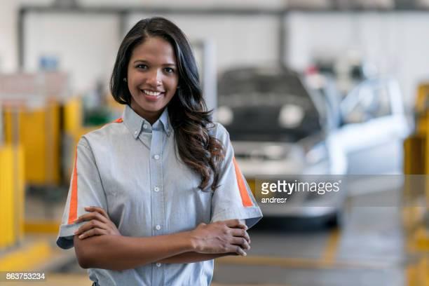 Female mechanic working at an auto repair shop
