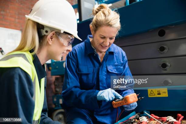 female mechanics hard at work - trainee stock pictures, royalty-free photos & images