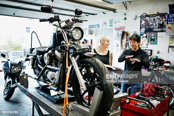 Female mechanics in discussion while in garage