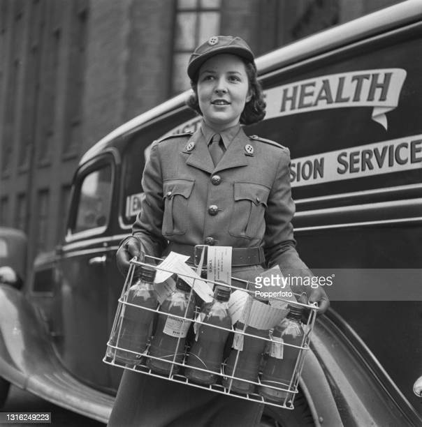 Female Mechanised Transport Corps driver loads a crate of blood products in to a Ministry of Health Emergency Blood Transfusion Service mobile unit...