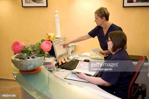 Female medical assistents in the reception area of a dental practice on May 14 2014 in Cologne Germany