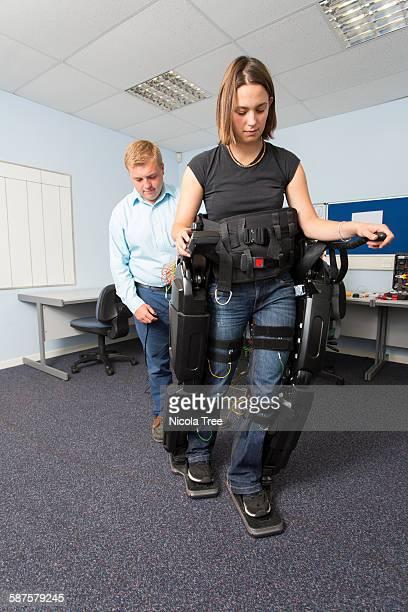 Female medical engineer testing a exoskeleton