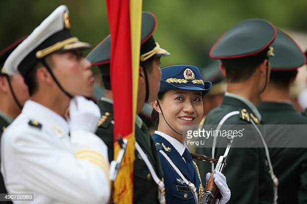 Female member of an honor guard smiles during a rehearsal before a welcome ceremony for Portuguese President Anibal Cavaco Silva held by Chinese...